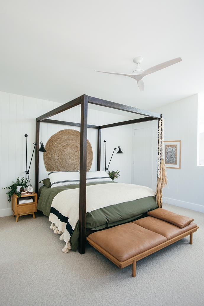 Kyal built the four-poster bed from hardwood salvaged from the original beach shack that was on site.