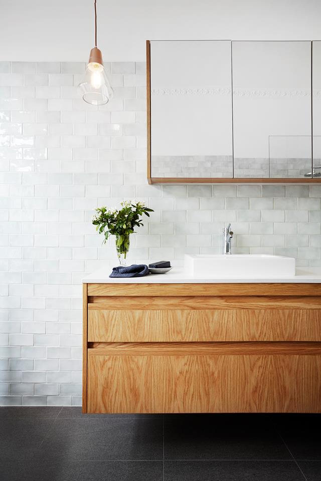 "A sense of proportion and a light touch are key to this shared [family bathroom](https://www.homestolove.com.au/a-flawless-family-bathroom-renovation-4149|target=""_blank""). The beautiful vanity was custom-made from solid Victorian ash and topped with Caesarstone in Frosty Carrina."