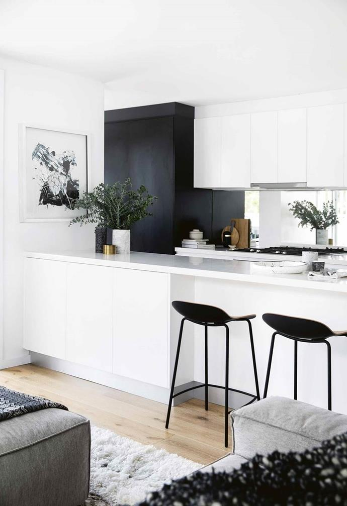 "If you're having difficulty choosing lights, mirrors can make a surprisingly excellent kitchen splashback, helping to enhance your home's natural light and create the illusion of space like in this minimalist [monochrome apartment on Sydney's Northern Beaches](https://www.homestolove.com.au/minimalist-apartment-northern-beaches-17911|target=""_blank"")."