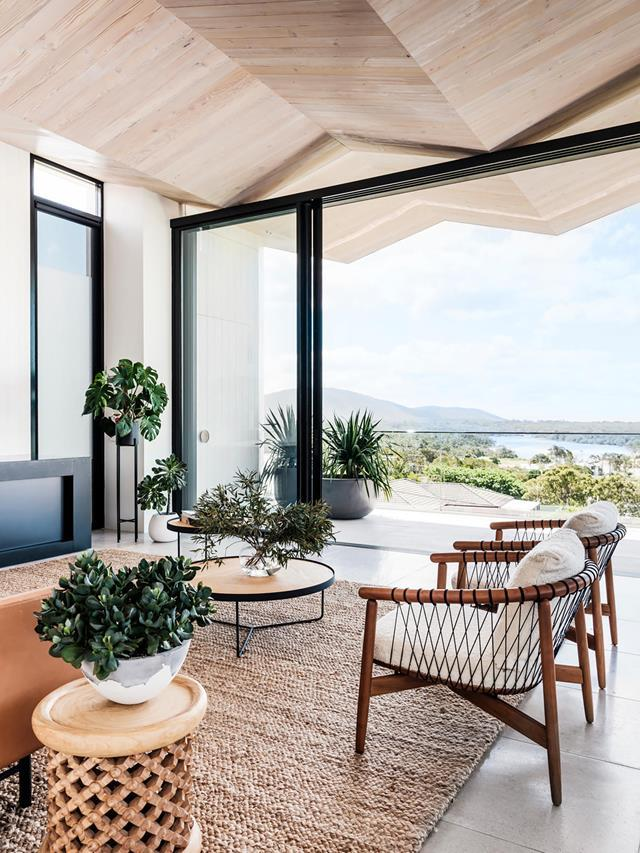 "With a ceiling that traces the peaks of nearby surf and mountains, this [coastal home](https://www.homestolove.com.au/luxury-coastal-apartment-with-breathtaking-views-20736|target=""_blank"") slots right in to its laidback surrounds. A variety of plants including succulents and monstera deliciosa help tie the space in with the landscape."
