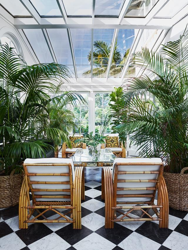 "On ground level at the rear of this [historic home](https://www.homestolove.com.au/youthful-redesign-of-a-historic-heritage-home-6113|target=""_blank""), a sunroom has been transformed into a Bahamas-plantation-style glasshouse drenched in light. Tamsin Johnson confessed to going ""a bit crazy with the palms and planting,"" but the soaring ceiling and double doors opening onto the lush garden was the perfect setting."