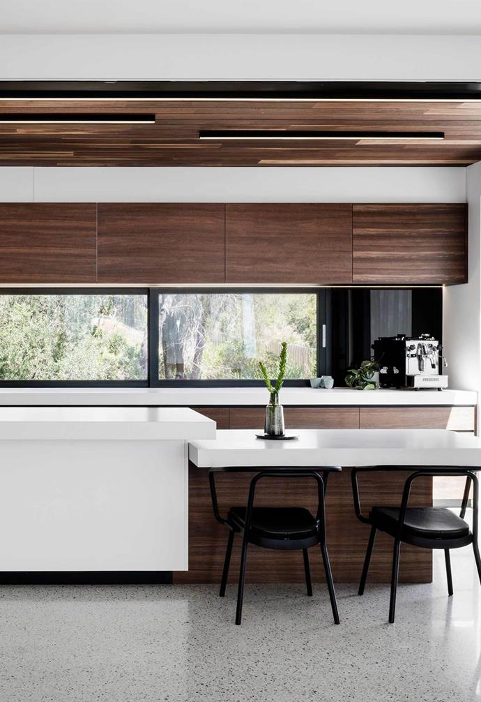"Function meets form in this [ultra-modern coastal home](https://www.homestolove.com.au/modern-coastal-house-19462|target=""_blank"") where the kitchen island features a designated seating zone which serves both a functional and aesthetic purpose. Long LED lights are spaced across the spotted gum lines of the ceiling, to be barely noticeable in the day and beautifully highlighted at night."
