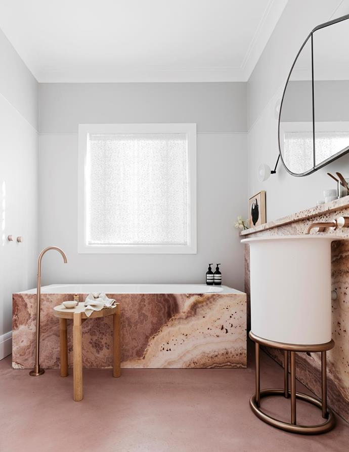 "This [pretty pink bathroom](https://www.homestolove.com.au/best-bathroom-design-belle-coco-republic-interior-design-awards-2018-6757|target=""_blank"") won Alexandra Donohoe Church of Decus the award for Best Bathroom Design at the Belle Coco Republic interior design awards. This bathroom oozes simple elegance with flooring in matt pink concrete and an onyx bath tub."