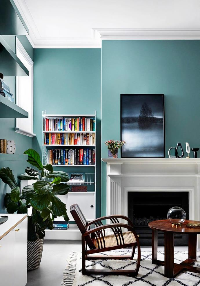 "The original fireplace had been removed so the owners of this [classic Edwardian house](https://www.homestolove.com.au/edwardian-house-interior-colours-19813|target=""_blank"") reinstated it along with ornate cornices.The splashes of pale turquoise in the living room set a warm and inviting tone. As the owner says, ""These colours seem to have the power to energise or soothe us, according to our mood."""