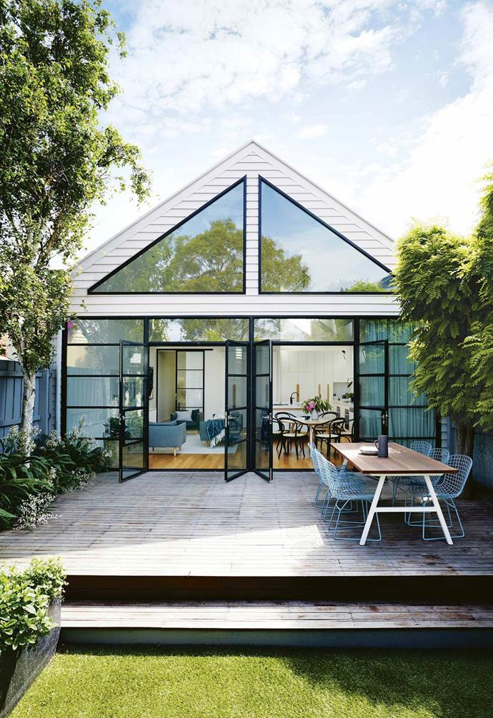 "Owners Rachael and Todd committed to a wall of black steel-framed windows and doors for the back exterior of their [Scandi-style house](https://www.homestolove.com.au/scandi-style-glass-house-extension-17515|target=""_blank"") which  elegantly juxtaposes the home's Victorian-era front facade."