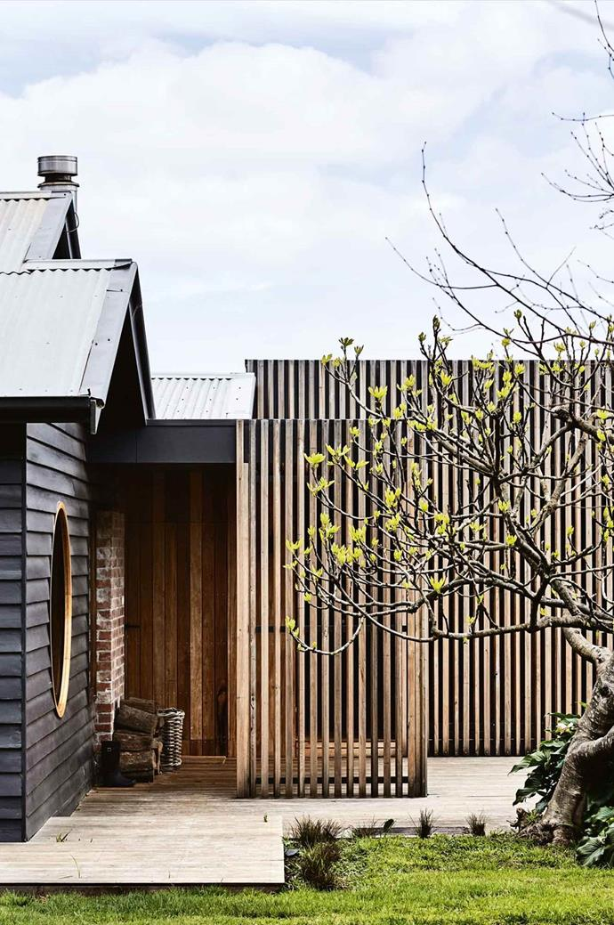"The [farmhouse at Hart's Farm](https://www.homestolove.com.au/farmhouse-extension-australia-13815|target=""_blank"") on Victoria's Mornington Peninsula was given a new lease on life with a modern timber extension. Here, we see the entrance to the original house and the slatted timber walkway connecting to the new bedroom wing."