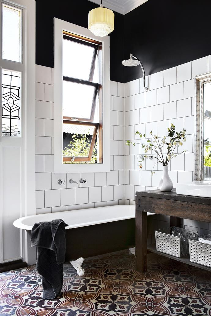 "You don't have to own a heritage home to create an Art-Deco bathroom. The black and white palette, vintage pendant and leadlight window in this bathroom are all references to Art-Deco style in a [new-build Perth home](https://www.homestolove.com.au/carla-and-bens-personality-filled-new-house-1799/|target=""_blank"")."