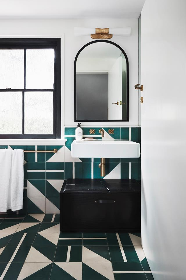 "The eye-catching pattern of this powder room is perfectly complemented by ""solid and handsome"" brass accents. The [Art-Deco home](https://www.homestolove.com.au/modern-art-deco-home-20290