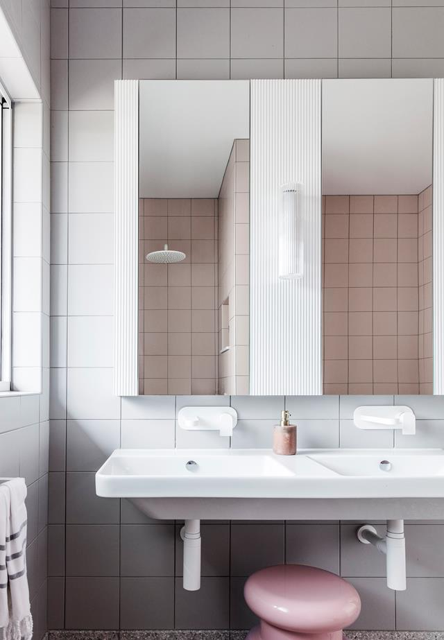 "The interior designer and owner of this [fully-renovated Newcastle home](https://www.homestolove.com.au/art-deco-style-honoured-in-renovation-of-newcastle-home-6661|target=""_blank"") chose to embrace the original bathroom's pink-and-grey scheme and introduce Art-Deco geometrical, graphic angles."