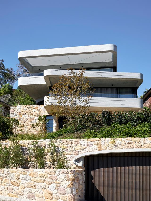 "Architect Luigi Rosselli followed his clients' brief to the letter in the design of this epic [stacked house](https://www.homestolove.com.au/a-stacked-house-in-harmony-with-its-cliff-side-location-6943|target=""_blank""). The garage was excavated into the rock. Each level of the house is oriented differently to suit the view and not impinge on the neighbours' outlook."