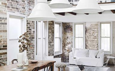 An all-white industrial-style home with minimalist charm