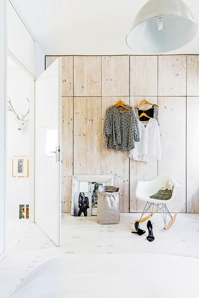 """Storage is maximised in the master bedroom with floor-to-ceiling cupboards. The timber has been whitewashed to suit the colour scheme of this [modern-industrial home](https://www.homestolove.com.au/gallery-mariekes-modern-industrial-home-2244