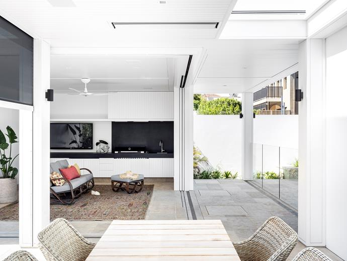 Pretzel sofa and footstool, Naturally Cane. Tribal rug, Robyn Cosgrove. Artusi built-in barbecue. Artetech Basaltine Nero benchtop, Artedomus. City Stik tapware, Brodware. Joinery by Nu Space.