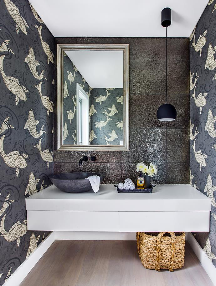 "A powder room is the perfect place to add some playful personality, and the bathroom in this [family-friendly Sydney home](https://www.homestolove.com.au/gallery-a-family-friendly-reno-with-a-hint-of-glamour-1454|target=""_blank"") has it in spades! Osborne & Little Folia Derwent wallpaper from Seneca Textiles is paired with jewel-like mosaic tiles from Di Lorenzo Tiles, creating a dramatic effect.<br><br>"