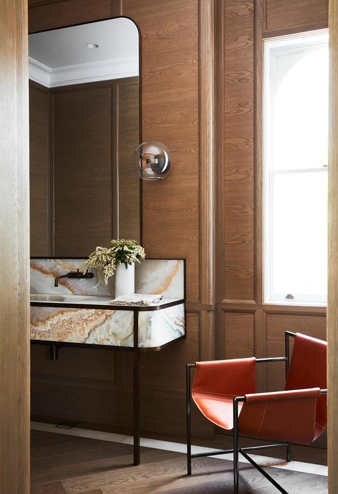 "This [heritage home](https://www.homestolove.com.au/heritage-property-fashioned-into-elegant-house-20094|target=""_blank"") was given a sophisticated and contemporary update that oozes luxury. In the powder room a statement white onyx vanity instantly draws the eye and contrasts beautifully with the deep timber floors and timber-clad walls. <br><br>"