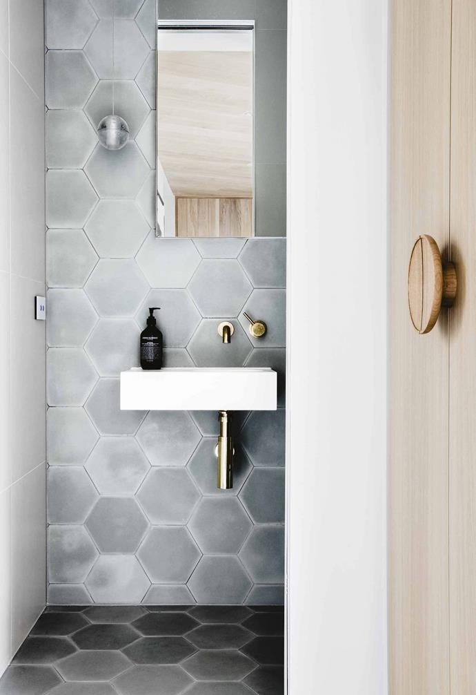 "The brief for this powder room was the creation of something beautiful and functional for the owners. ""I really wanted to make the home high-end but with a touch of warmth and handmade elements,"" says interior architect Georgia Ezra of [Studio Ezra](https://www.studioezra.com/