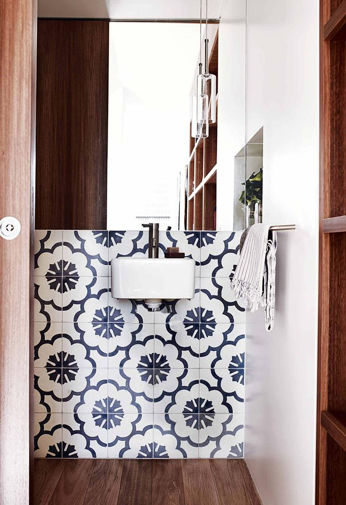 """Bespoke joinery was the hero in the area leading into the powder room, so a large mirror reflects the details of that timberwork in this [multigenerational home in Balmain](https://www.homestolove.com.au/multigenerational-living-home-17001 target=""""_blank""""). The recessed sliding door is a great space saver, allowing the bathroom to disappear alongside the joinery when a streamlined look is needed.<br><br>"""
