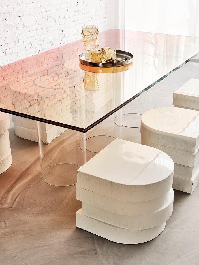 The ombré glass topping the dining table is a test panel from a previous project. Chairs designed by Sabine and Paul and constructed from stacked foam and resin add a sculptural element.