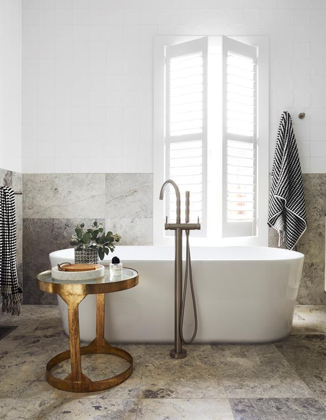 "A Posh Solus freestanding bath is the main feature in this warm-grey honed Turkish limestone bathroom in a [functional yet luxurious home on the Mornington Peninsula](https://www.homestolove.com.au/functional-yet-luxurious-home-on-the-mornington-peninsula-20568|target=""_blank"")."