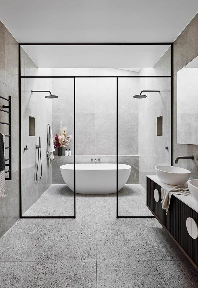 "A freestanding bath takes centre stage in this sleek, contemporary bathroom in a [completely transformed old Melbourne home](https://www.homestolove.com.au/the-block-alisa-lysandra-albert-park-renovation-19416|target=""_blank"")."