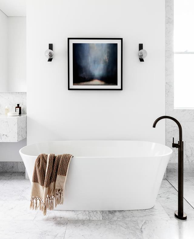 "A Victoria + Albert 'Vetralla' freestanding bath blends into the sophisticated monochrome palette of this marble bathroom in a [graciously renovated Victorian terrace](https://www.homestolove.com.au/revived-victorian-terrace-21184|target=""_blank"")."