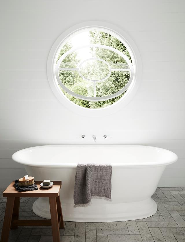 "A simple freestanding bath sit beneath a circular peeping window like a mirror in this [farmhouse-meets-coastal Bowral family home](https://www.homestolove.com.au/family-home-with-character-in-the-nsw-southern-highlands-20547|target=""_blank"")."