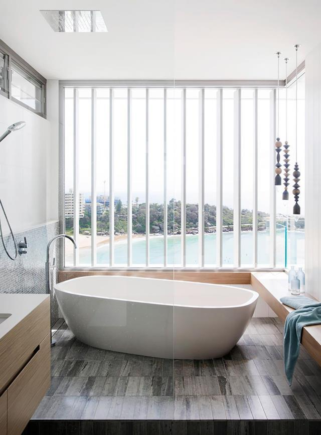 "Indulgent soaking is easy in the Apaiser 'Sublime' tub in this [elegant cliffside home in Sydney's north](https://www.homestolove.com.au/cliffside-home-in-sydneys-north-19608|target=""_blank""), which boasts spectacular coastal views filtered through automated aluminium louvres."
