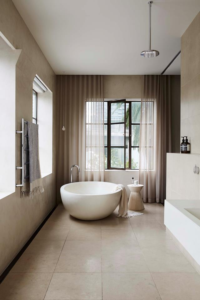 "A sweet egg bath sits upon San Sebastian limestone floor tiles from Artedomus in a [refined oasis home in a former Melbourne showroom](https://www.homestolove.com.au/a-refined-oasis-in-a-former-melbourne-showroom-19050|target=""_blank"")."