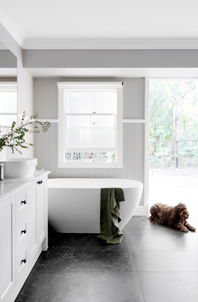 "The sweet little freestanding bath of this family-friendly bathroom is just enough luxury for [a heritage Queenslander home](https://www.homestolove.com.au/block-contestants-renovate-heritage-queenslander-home-19196|target=""_blank"")."