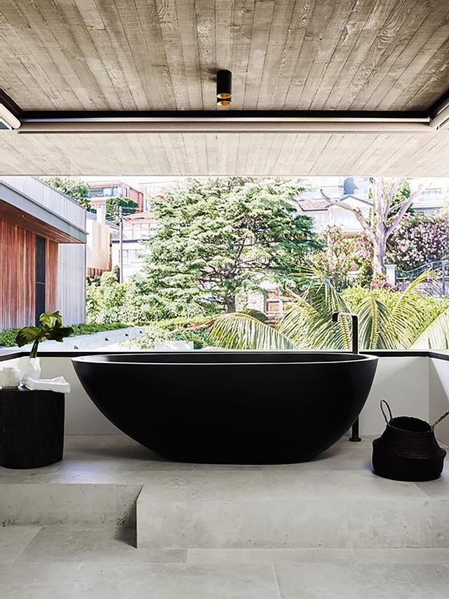 "A black Moda 'Lucia' freestanding bath makes a dramatic statement against the earthier tones of ochre, chocolate and terracotta used in this [modernist home with a maximalist interior](https://www.homestolove.com.au/a-modernist-home-with-a-maximalist-interior-6555|target=""_blank"")."