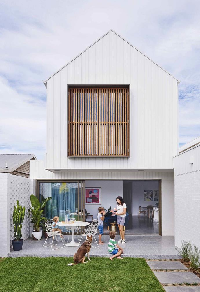 """The facade of this [two-storey home](https://www.homestolove.com.au/contemporary-house-geelong-17561