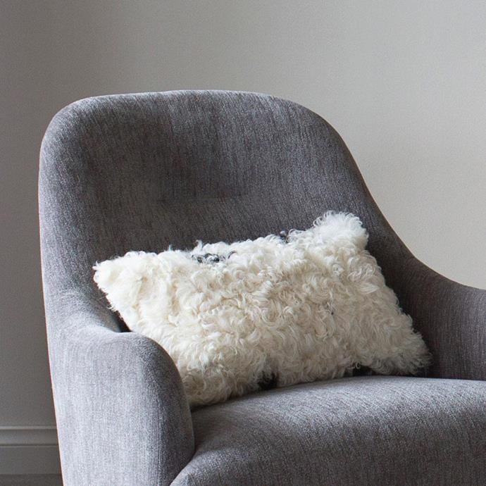 "Sheepskin Cushion - Black and White, $132, [Curious Grace](https://curiousgrace.com.au/products/sheepskin-cushion-black-and-white?_pos=5&_sid=d503e8fe9&_ss=r|target=""_blank"")"