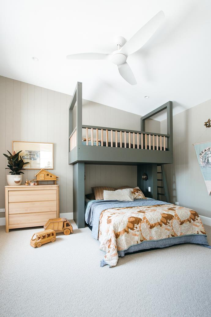 Kyal custom built the bunk beds which have been painted in Taubmans Endure 'Charcoal Grey'.