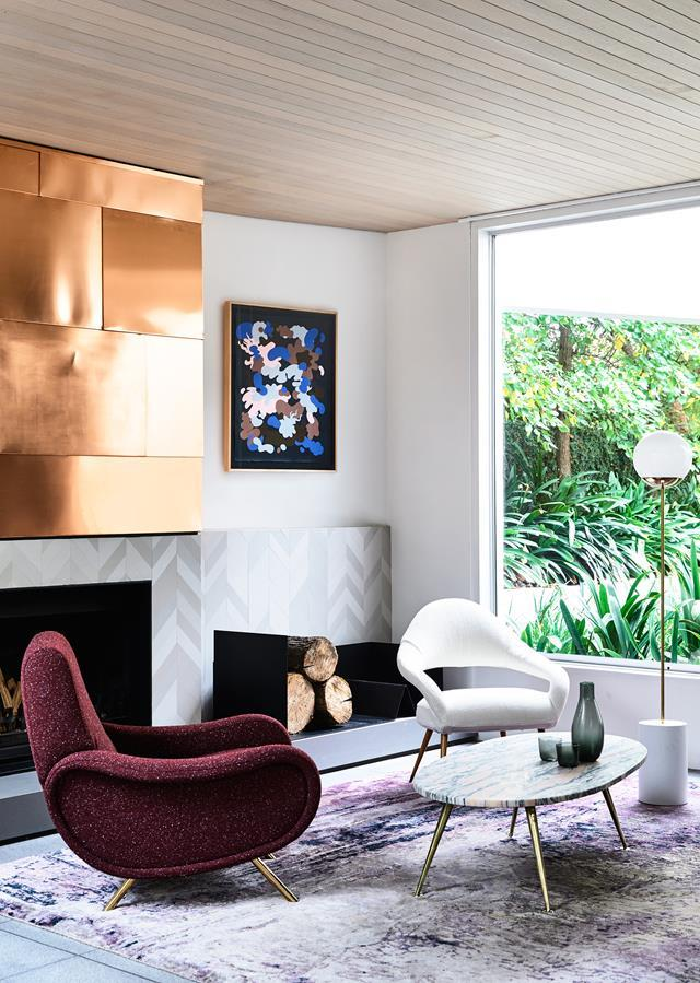 "With its strong geometric shapes and bold colours, this [1980s home](https://www.homestolove.com.au/a-striking-home-renovation-inspired-by-the-80s-5128|target=""_blank"") stands out from the neighbouring classical crowd. Copper sheeting, from George White, on the fireplace brings a touch of metallic glamour and extra warmth to the sophisticated living space."