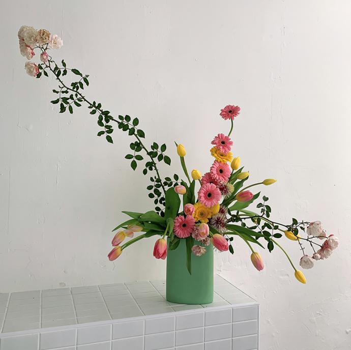 "[Hattie Molloy x Mud](https://mudaustralia.com/product/mud-oval-vase-hattie-molloy-flowers/ target=""_blank"" rel=""nofollow"") arrangement."