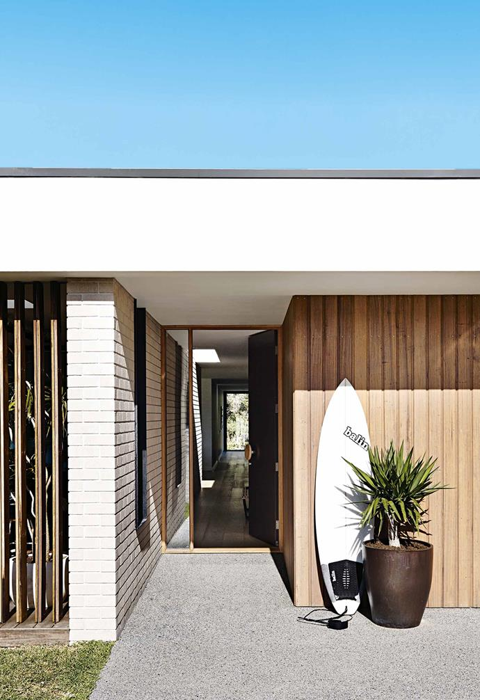 """Sunken snugly into the native landscape and surrounded by tea trees, the restrained lines of the house contrast with the rugged coastal environment without jarring or imposing.<br><Br>**Entry** The mix of timber and white bricks for the [exterior](https://www.homestolove.com.au/wall-cladding-ideas-16125