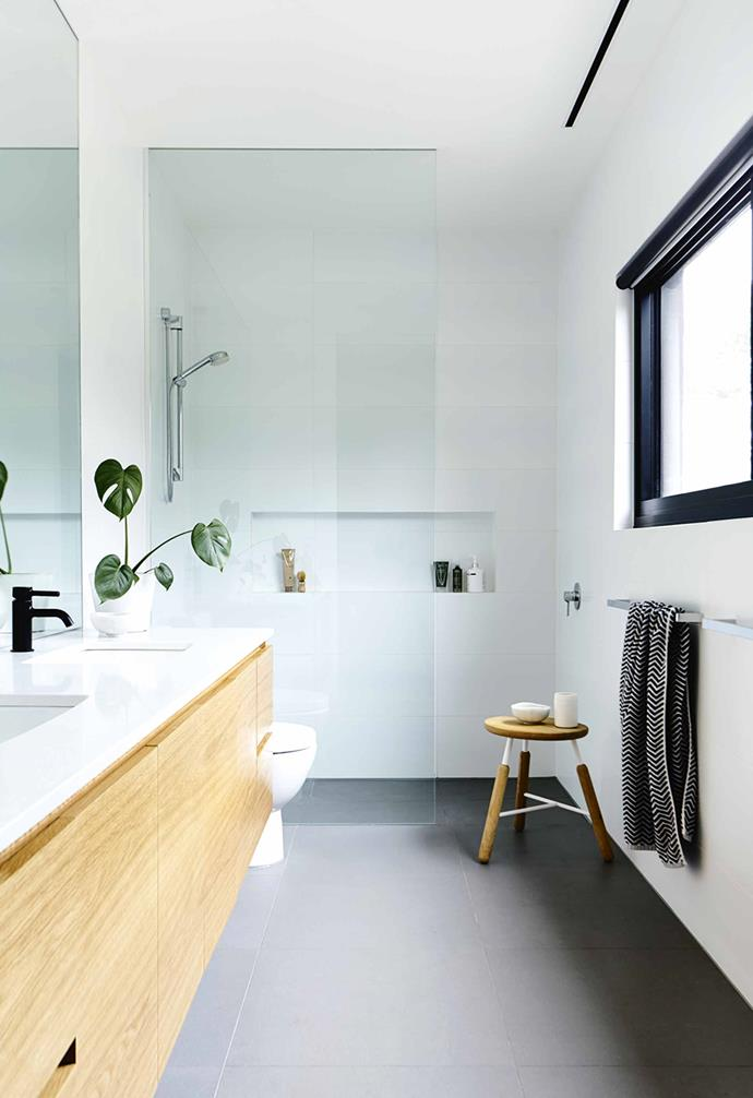 The house is just big enough to accommodate the entire McKimm clan, which includes Andrea and Chris's four children, who flock here regardless of the season.<br><br>**Bathroom** Smart timber-veneer joinery with an Essastone top offer storage.
