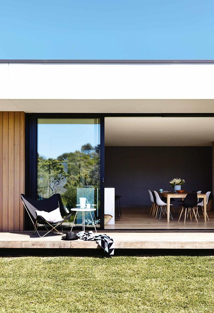 """A flat plane projecting from the roof forms a covered deck that runs the entire length of the house. It's the perfect spot for summer [outdoor entertaining](https://www.homestolove.com.au/6-tips-for-outdoor-entertaining-4632