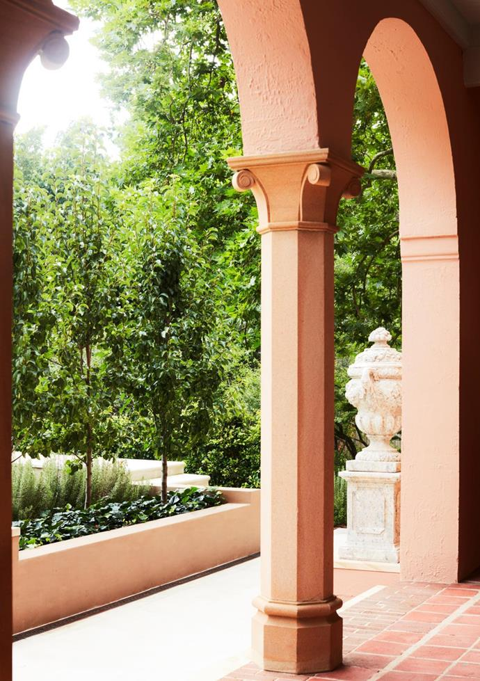 Grand arches at the portico signal the elegance of the home within. The soft-terracotta exterior colour is Porter's Paints Ferento. Landscape design by Peter Fudge Gardens.