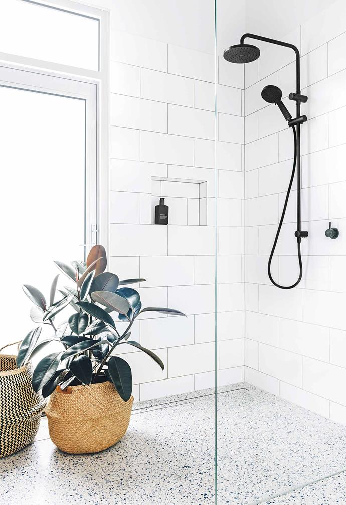 """Putting on hold their dreams of making over the super colourful interiors throughout – think orange and red walls – the couple made the wet areas and wardrobe their first priority. """"We felt that with such a [large ensuite](https://www.homestolove.com.au/ensuite-bathroom-design-ideas-18820