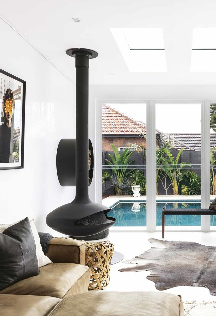 """The suspended fireplace makes a dramatic statement in this [tropical-style home](https://www.homestolove.com.au/tropical-resort-style-home-18497