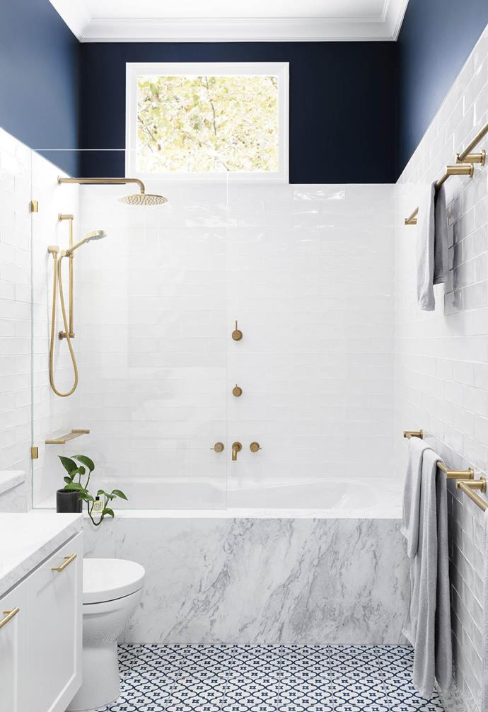 A combined bath/shower fits neatly into the end of this bathroom designed by GIA Bathrooms & Kitchens. A frameless glass screen separating the wet from dry zones ensures sight lines travel all the way to the end.