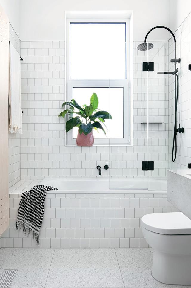 """Using the exact same material for the bath and wall behind is a great way to create the illusion of more space as seen with this [monochrome bathroom](https://www.homestolove.com.au/scandinavian-inspired-home-12192