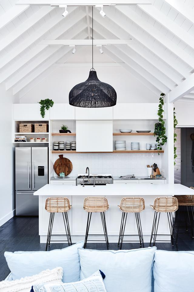 "In [SOUL of Gerringong](https://www.homestolove.com.au/coastal-farmhouse-reno-gerringong-18827|target=""_blank""), a stylish Airbnb on the NSW South Coast, a statement rattan pendant in the kitchen highlights the raked ceiling while adding a to the coastal-farmhouse feel."