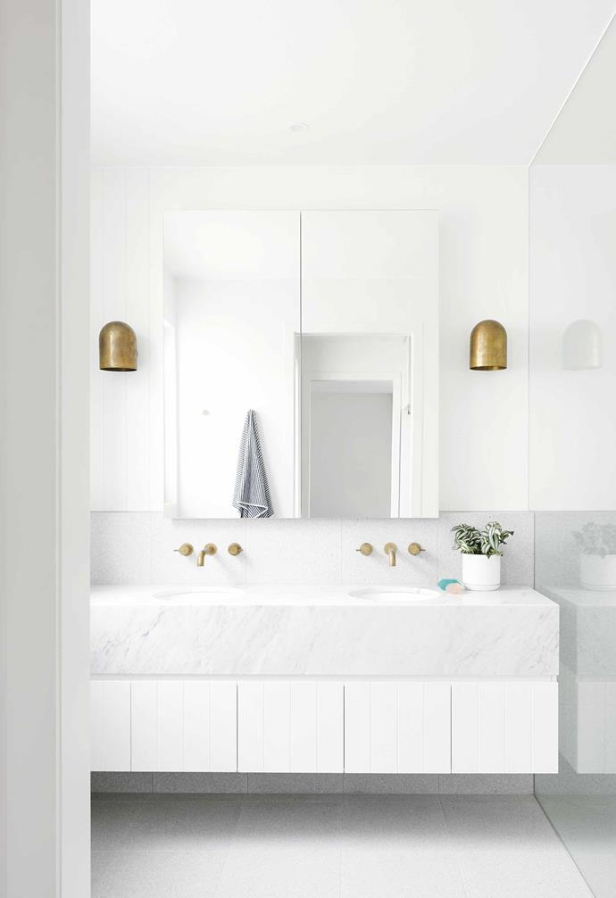 "This [contemporary home in Geelong](https://www.homestolove.com.au/contemporary-house-geelong-17561|target=""_blank"") features a crisp white bathroom with brushed brass accents for an extra touch of glamour."