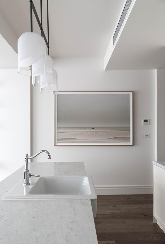 "Three minimalist but striking 'Moni Triple Pendant' from Articolo Lighting hang in a [luxury apartment in St Kilda](https://www.homestolove.com.au/luxury-accommodation-in-st-kilda-boasts-timeless-aesthetic-20382|target=""_blank""), Melbourne, which has been masterfully revamped by stylist studio The Specified."