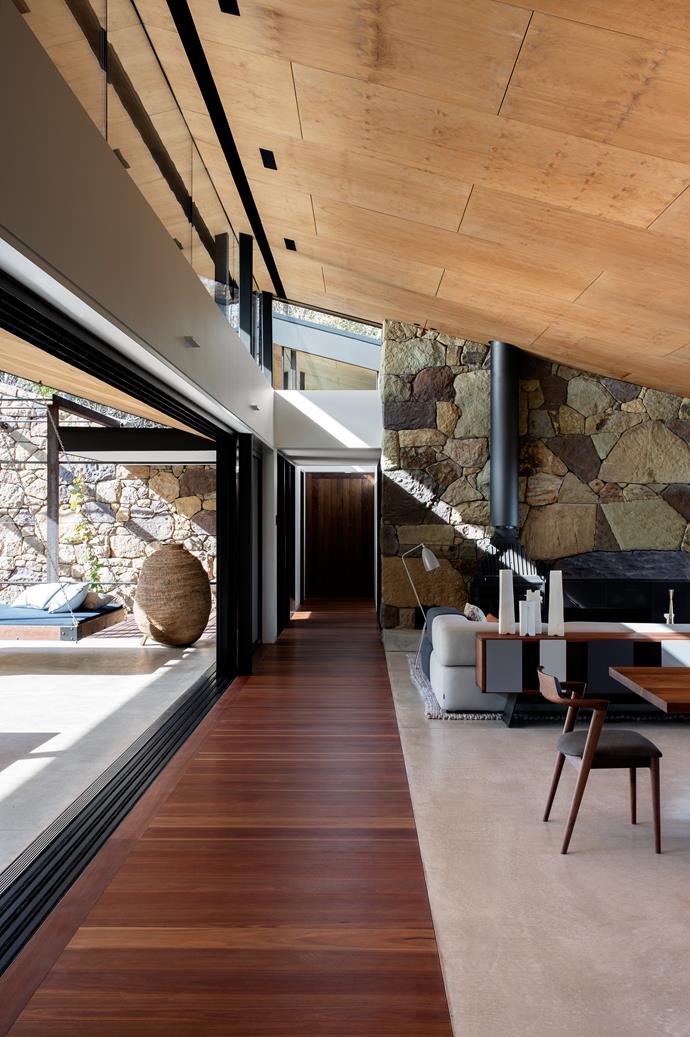 """A pitched plywood-clad ceiling is the crowning feature in the living room of this [incredible South Coast home](https://www.homestolove.com.au/a-home-up-high-on-the-south-coast-of-nsw-4569
