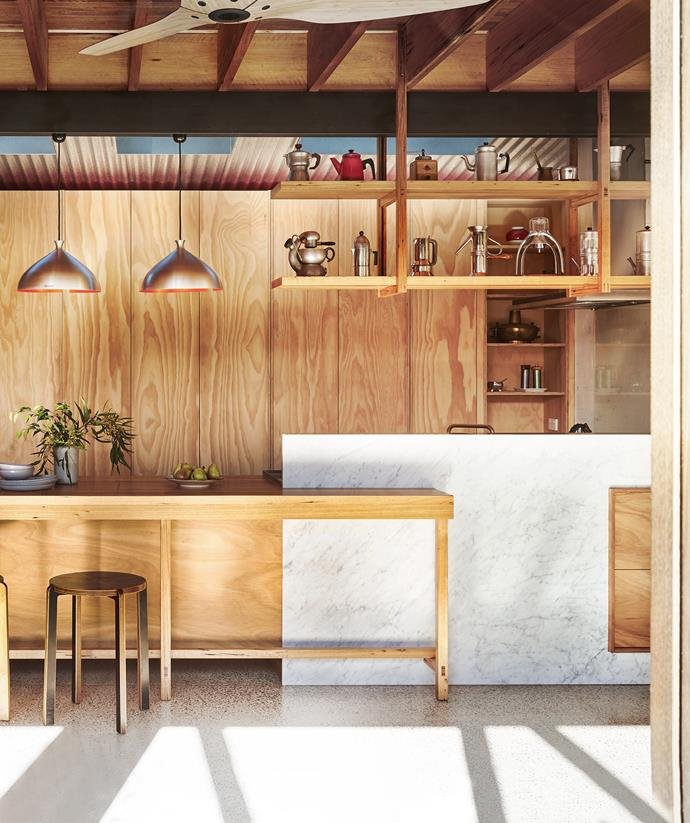"""Blackbutt plywood was used throughout the kitchen in this [sustainable Melbourne home](https://www.homestolove.com.au/sustainable-home-by-form-architecture-furniture-5702