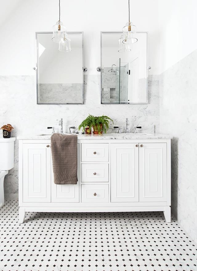 "Carrara marble subway tiles, floor tiles and vanity benchtop are a luxurious touch in the bathroom of this [Hamptons meets English country-style abode](https://www.homestolove.com.au/southern-highlands-home-with-english-country-meets-hamptons-style-20590|target=""_blank"")."