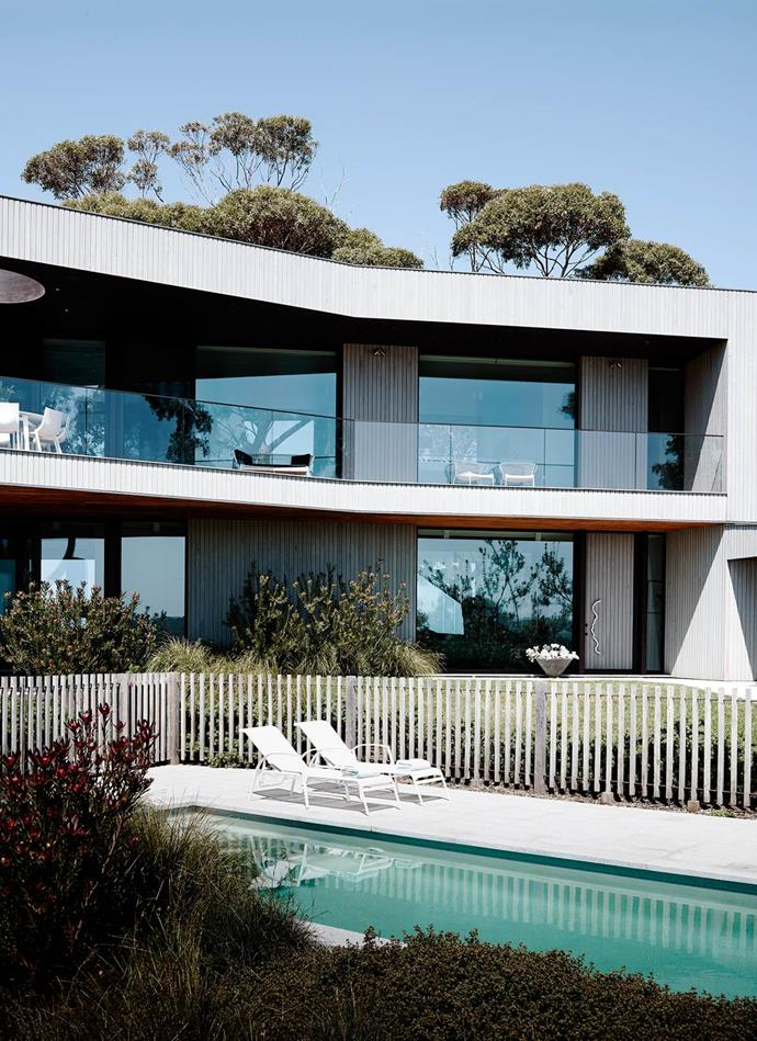 """Sitting atop an escarpment in Victoria's Mornington Peninsula, this house has views of the roaring sea facing south and rolling paddocks towards the north. """"The two facades are not seen together yet co-exist,"""" says architect Reno Rizzo of Inarc, who responded to the elements by designing a confident yet welcoming [holiday house](https://www.homestolove.com.au/two-for-one-holiday-house-4430